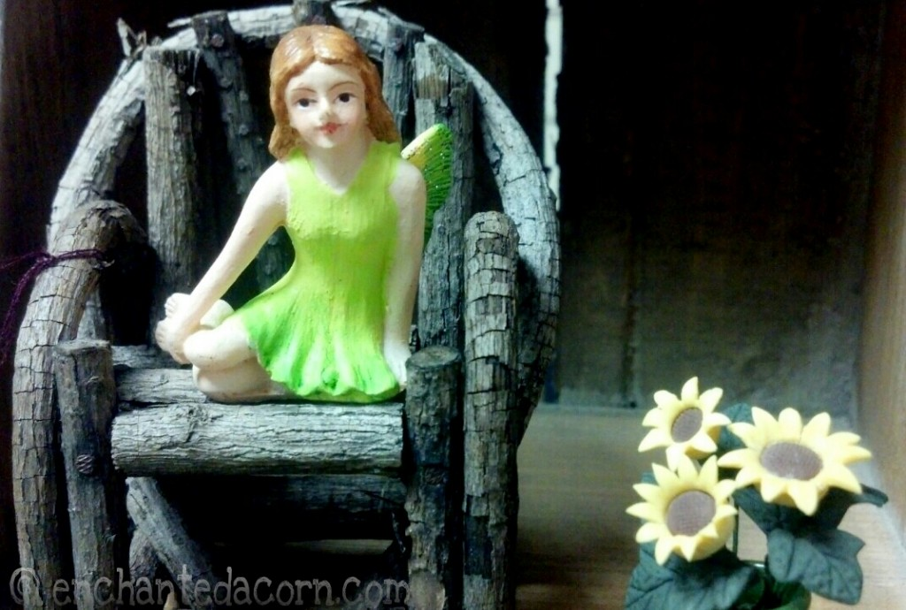 Green Fairy sitting on twig chair